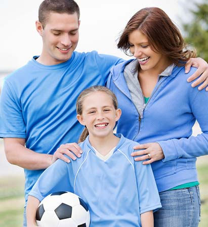 Parents supporting child in sports